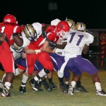 Blountstown Tiger quarterback Hunter Jordan (#14) is gang tackled by a pack of Marianna Bulldogs.