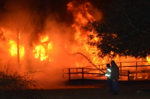 Flames destroy mobile home at Green Acres Monday night