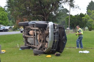 Truck overturns three times, trapping driver