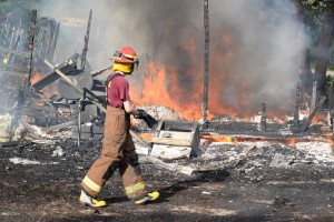 Fire levels wood-frame  home; cause unknown