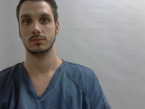 Man charged after fleeing, racing into  Jackson County