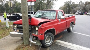Man runs from scene after clipping driver's ed van & hitting utility pole
