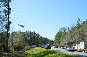 The emergency helicopter leaves the scene after picking up a seriously injured man Friday afternoon in Calhoun County.