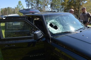 The automotive starter went through the windshield of this Jeep, hitting the passenger's arm.