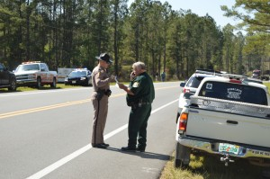Trooper Ron Ward talks with Calhoun County Sgt. Ricky Mayo, who was the first to arrive at the accident scene.